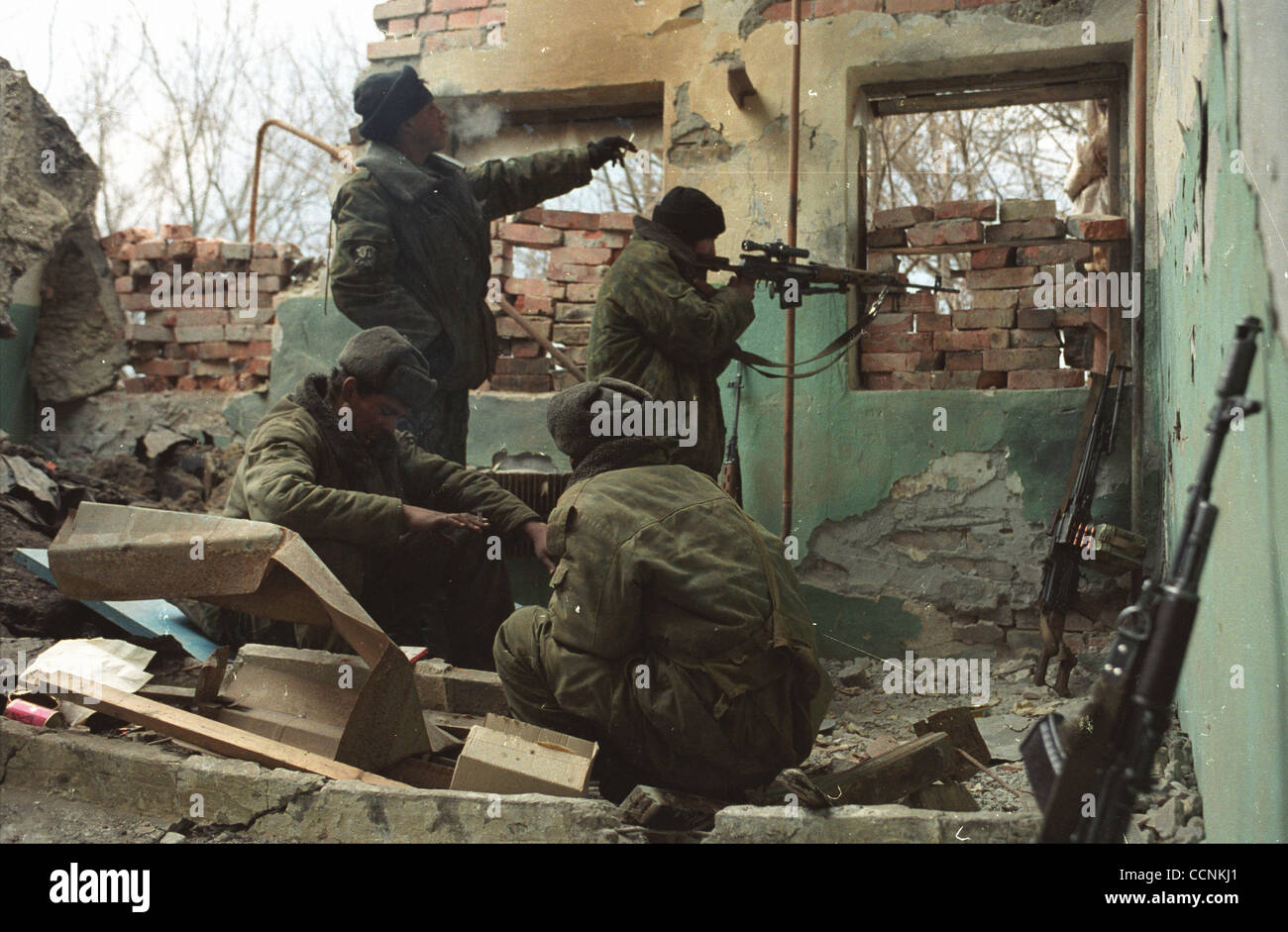 Snipers of russian federal troops at the army operation in Grozny suburbs to destroy chechen rebels. - Stock Image