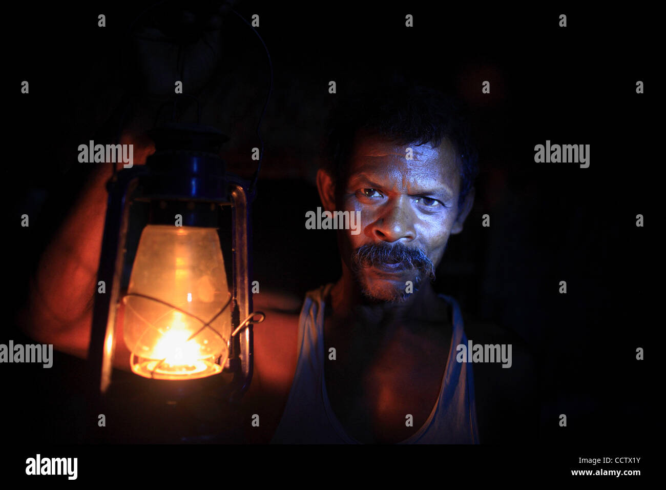 Traditionally in India, the Kerosene lamp has been the only source of light in most poor rural villages.  Ramprit - Stock Image