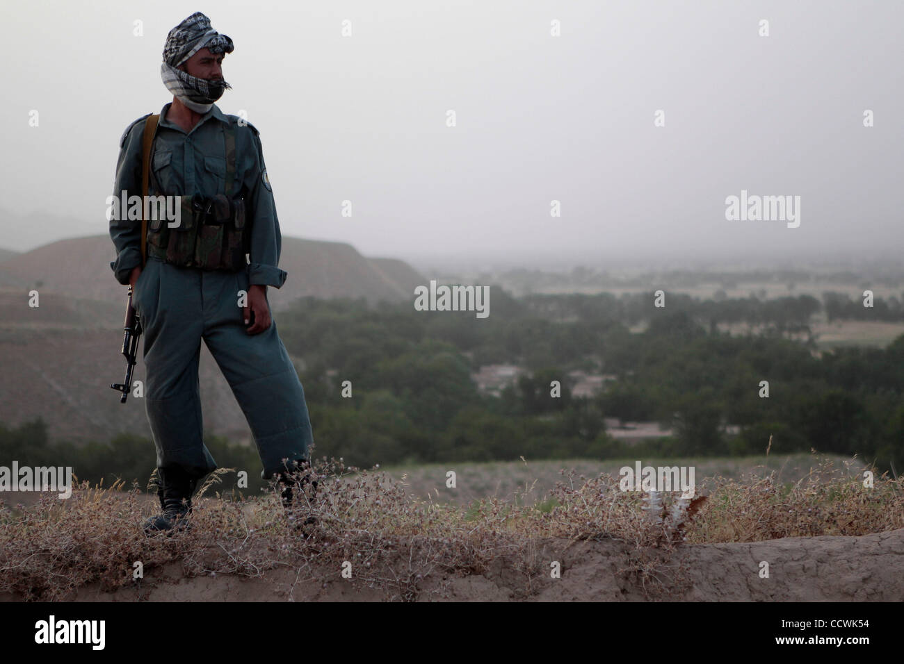 May 25, 2010 - Badghis Province, Afghanistan – An Afghan National Police soldier secures what will become Observation Stock Photo