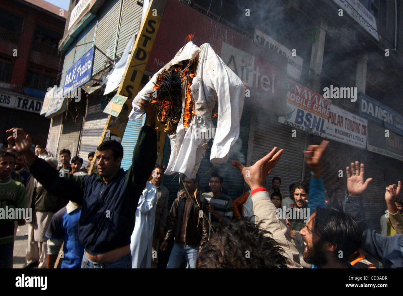 Kashmiri Muslim protestors burn a effigy of Pakistani President Asif Ali Zardari after his recent statement in which - Stock Image