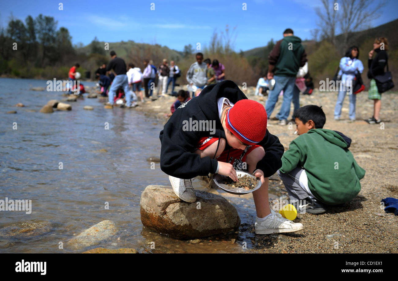 OUTBOUND LEDE --  Miles Nowack, 10, a 4th grader at Genevieve Didion School, pans or gold at the Marshall Gold Discovery - Stock Image