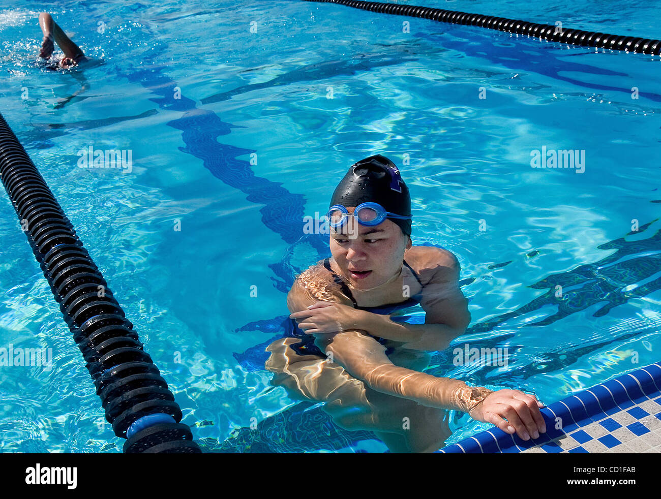 Franklin High School senior Stephanie Yu practices with her teammates at the Wackford Aquatic Center in Elk Grove - Stock Image
