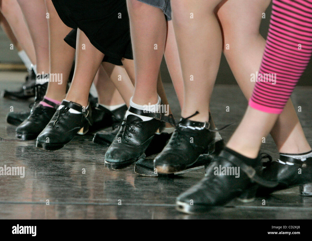March 11, 2008, San Marcos, California, USA_Detail view of dancer's hard shoes pounding loudly on the hard wooden - Stock Image