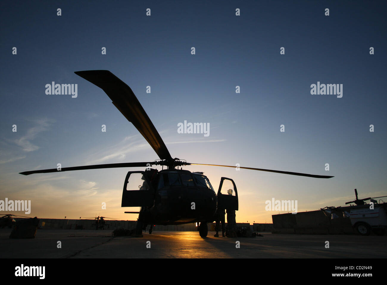Mar 13, 2008 - Baghdad, Iraq - A US Army UH-60 Blackhawk helicopter receives after- flight maintenance on the flightline - Stock Image