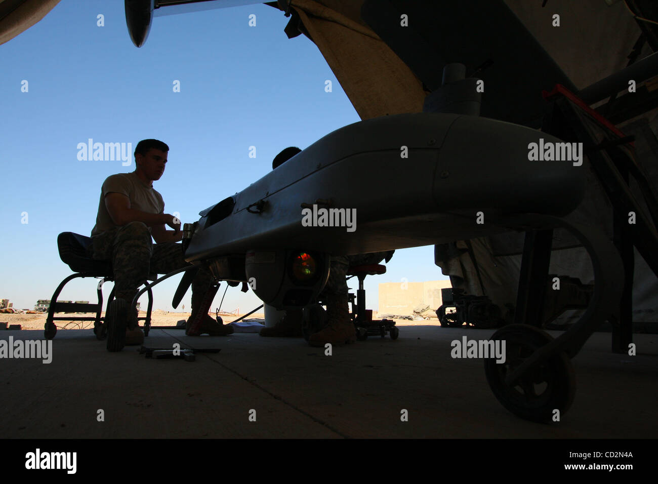 Mar 13, 2008 - Baghdad, Iraq - US soldiers work on an unmanned aerial vehicle inside a maintenance tent next to - Stock Image