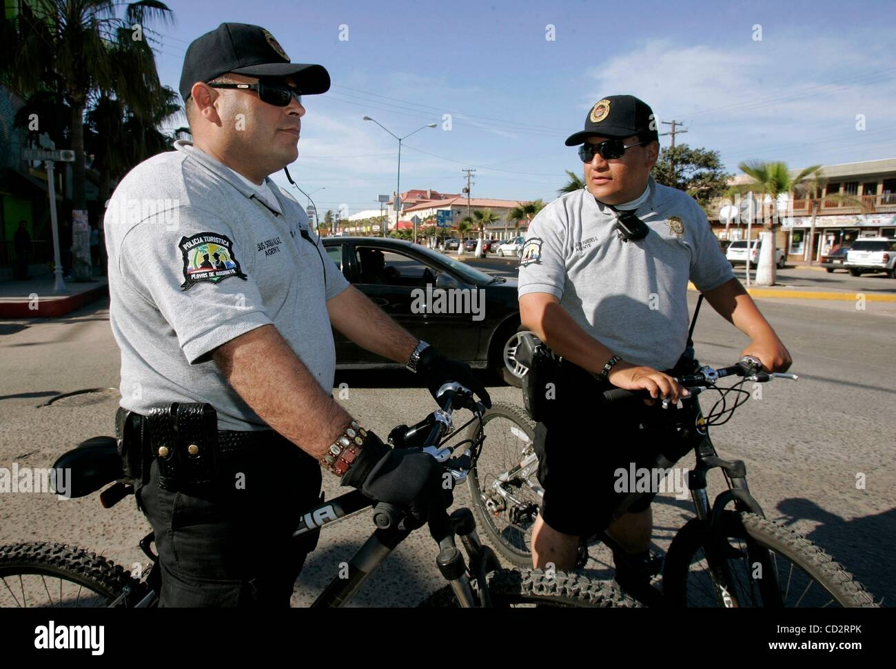 Mar 19, 2008 - Rosarito Beach, MEXICO - Rosarito Beach Tourist Police officers on bicycles JESUS SOQUI GALAZ, left, - Stock Image