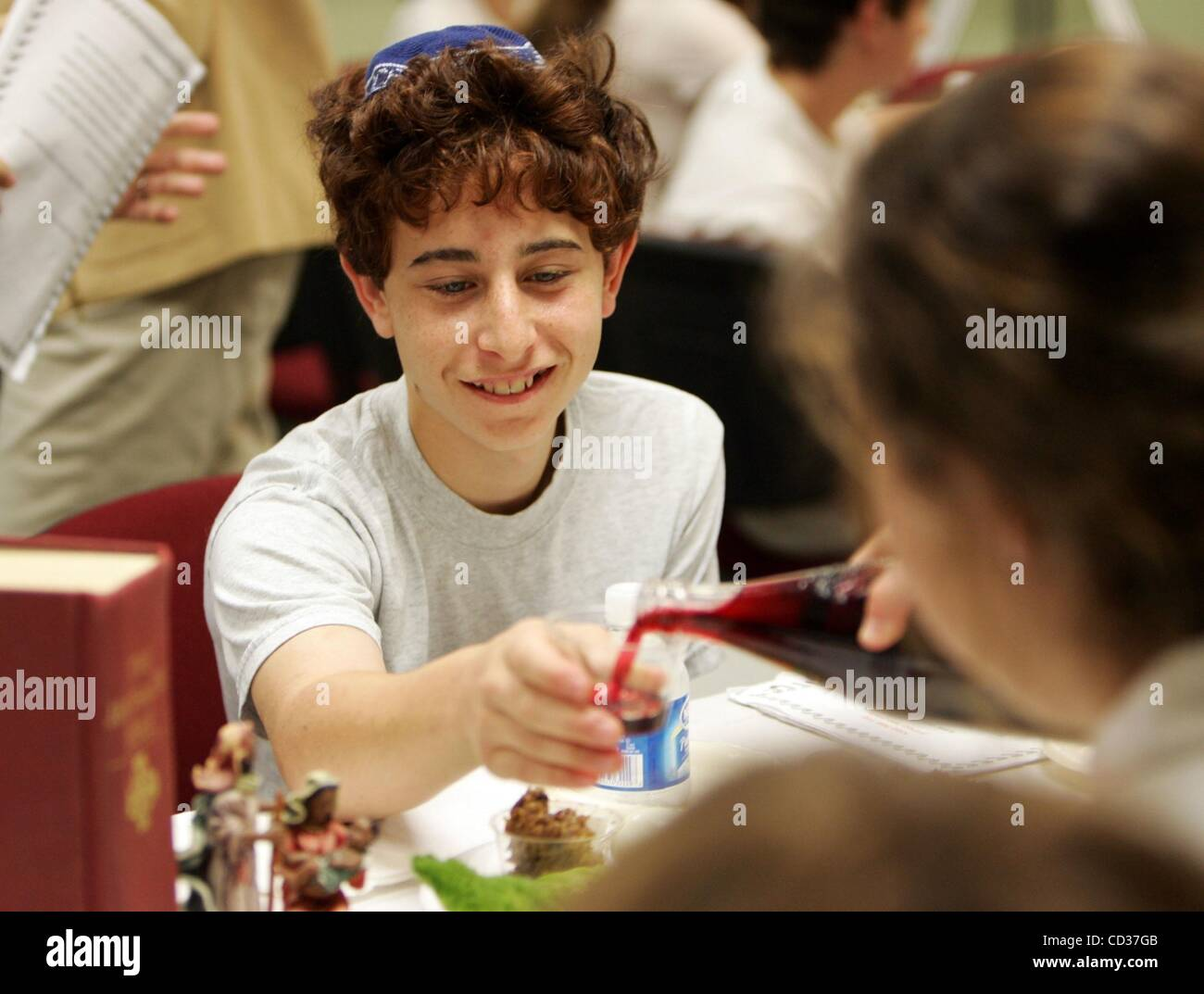Apr 17, 2008 - West Palm Beach, Florida, USA - ALBERT KRANZ, 13, accepts some wine (grape juice) during a Passover - Stock Image