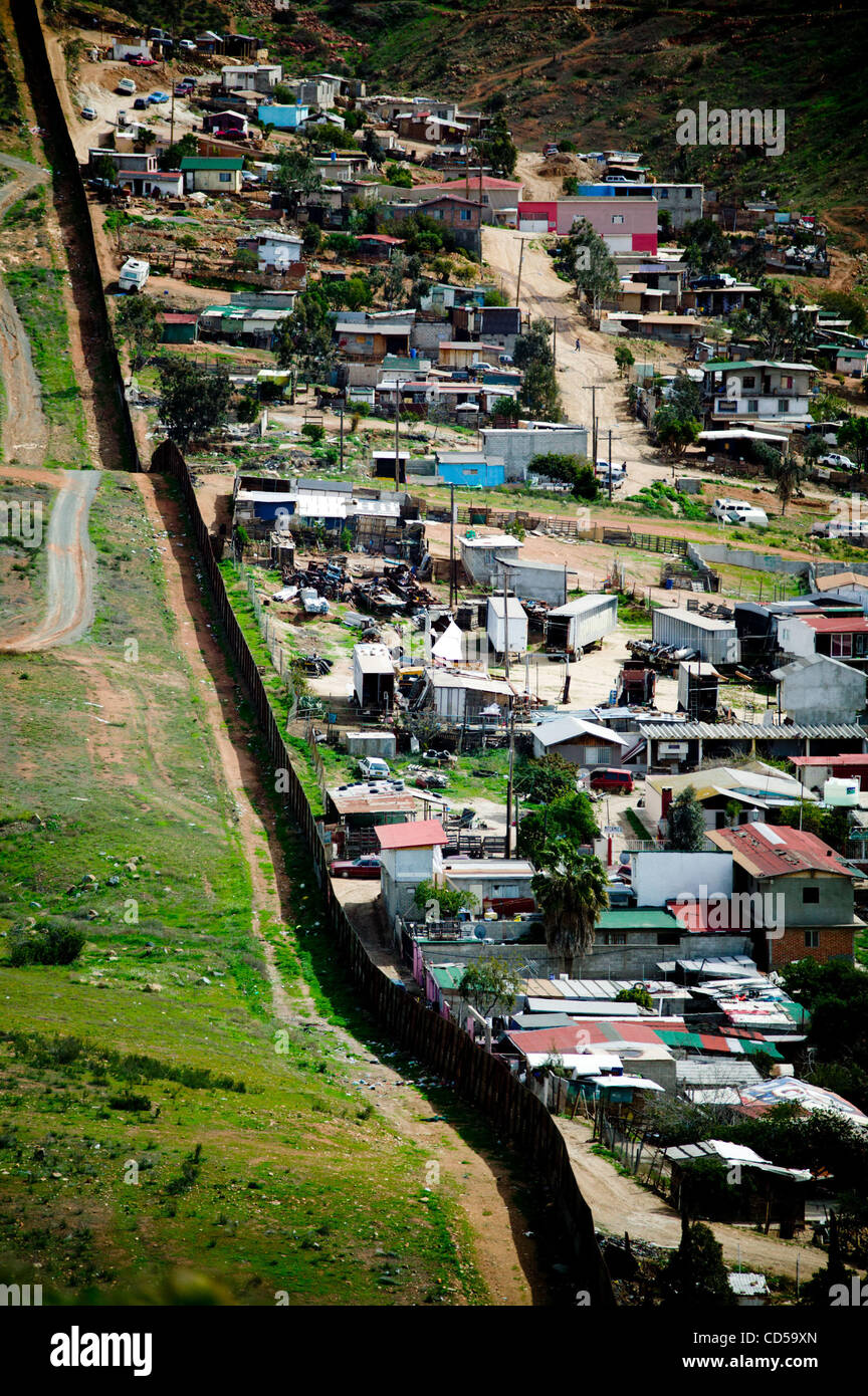 Tijuana viewed from the American side over the border wall Stock Photo