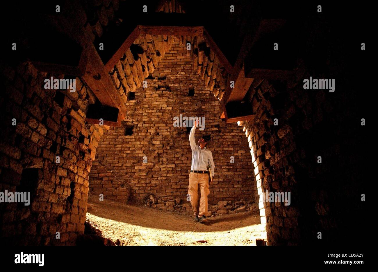 Mar 01, 2008 - Tallil, Iraq - Curator DIEF MOHSSEIN NAIIF AL-GIZZY shows one of the royal tombs at the SumerianStock Photo