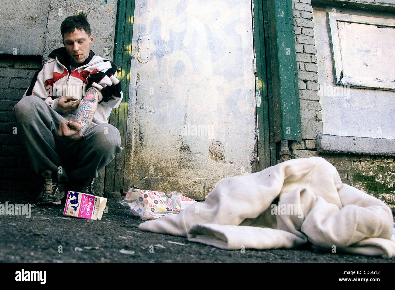 Jun. 12, 2008 - Vancouver, British Columbia, Canada - Dope sick and broke, Phil 'gets better' in the alley - Stock Image