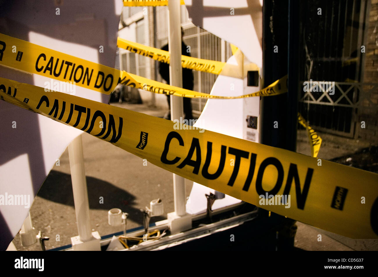Jun 12, 2008 - Vancouver, British Columbia, Canada - Caution tape keeps transit riders away from a bus shelter after Stock Photo