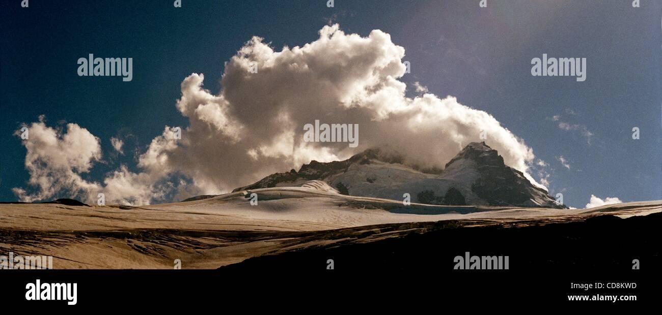 Nov 21, 2008 - Bariloche, Rio Nego, Argentina - Clouds pour over the peak at Cerro Tronador, the nearside located - Stock Image
