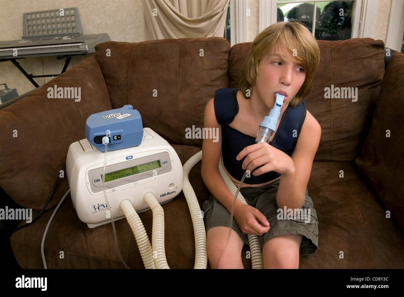 Jun 12, 2010 - Roswell, Georgia, U.S. - GAVIN BAKER, 11, takes one of his twice-daily percussion and breathing treatments - Stock Image