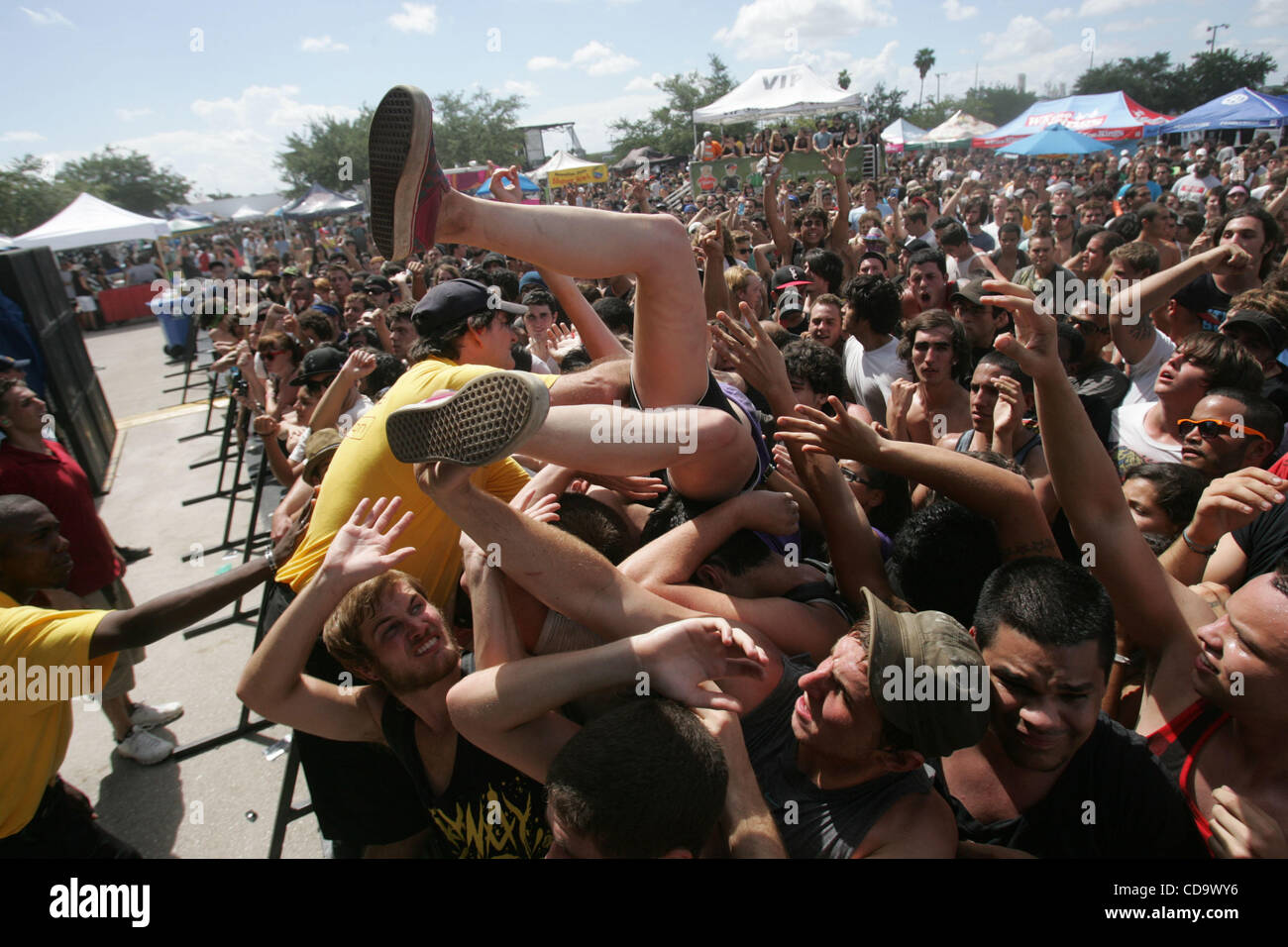 July 24, 2010 - West Palm Beach, Florida, US - A fan loses support while crowd surfing during the Vans Warped Tour - Stock Image