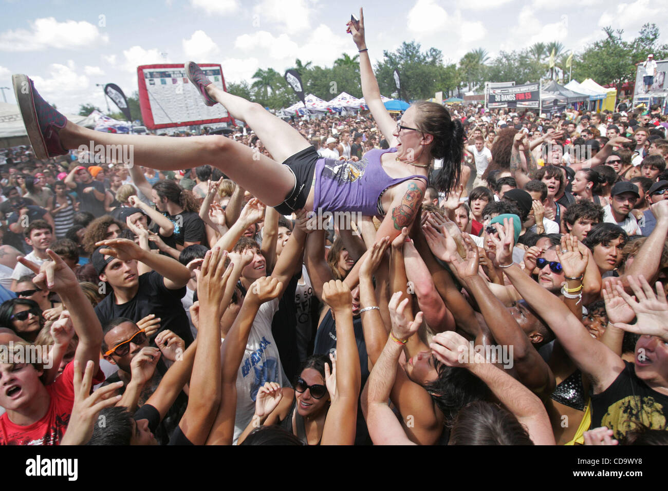 July 24, 2010 - West Palm Beach, Florida, US - A fan successfully crowd surfs to the front of the stage during the - Stock Image