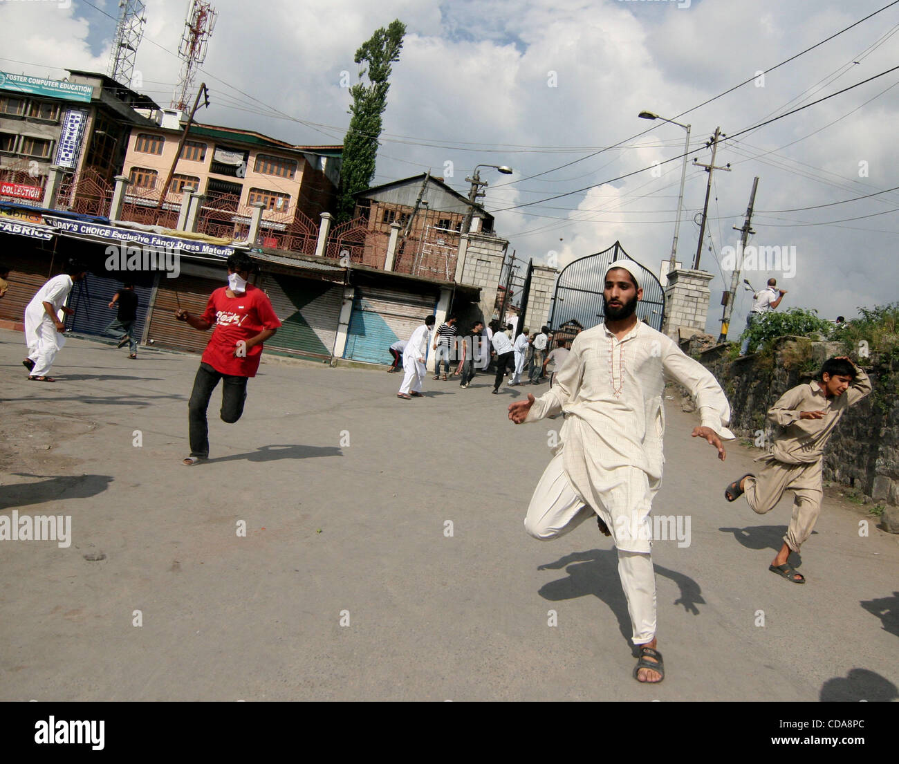 Kashmiri Muslim protestors run for cover during clashes in Srinagar, the summer capital of Indian Kashmir on Friday, - Stock Image