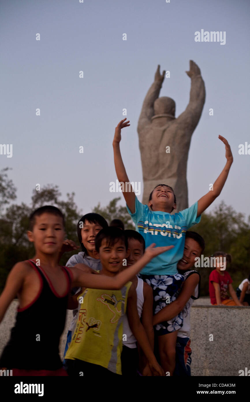 Sep 03, 2010 - Baikonur, Kazakhstan - School boys come play at the Gagarin park at dawn. They are proud to live - Stock Image