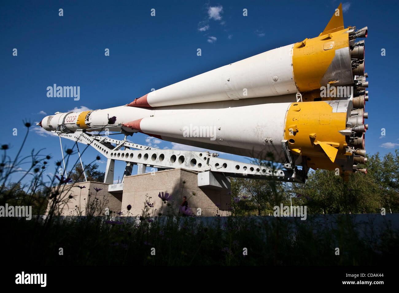 Sep 03, 2010 - Baikonur Cosmodrome, Kazakhstan - Baikonur Cosmodrome. Children play hide-and-seek by the Soyuz rocket - Stock Image