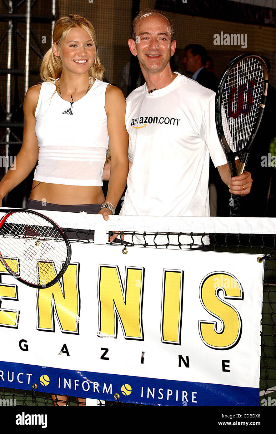 K32368AR.ANNA KOURNIKOVA AND JEFF BEZOS (OF AMAZON.COM) .INTRODUCE ANNA'S NEW SPORTS BRA, .''SHOCK ABSORBER''.AT TENNIS MAGAZINE'S GRAND SLAM; .AN ALL DAY TENNIS FESTIVAL .HELD IN GRAND CENTRAL TERMINAL'S VANDERBILT HALL IN NEW YORK New York. .8/22/2003.     /    2003(Credit Image: © Andrea Renault Stock Photo