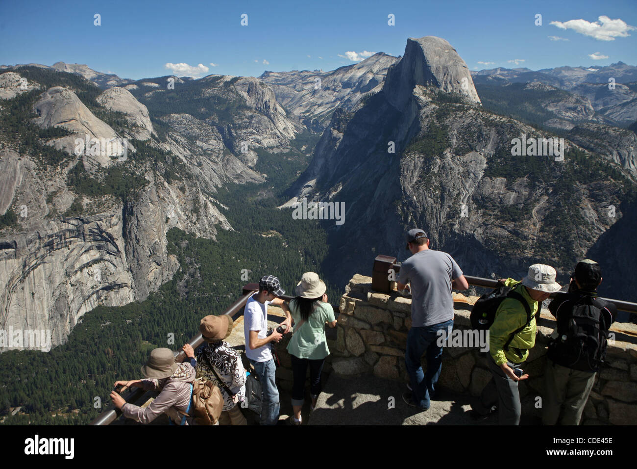 Tourist and Half Dome in Yosemite National Park  2011 is shaping up