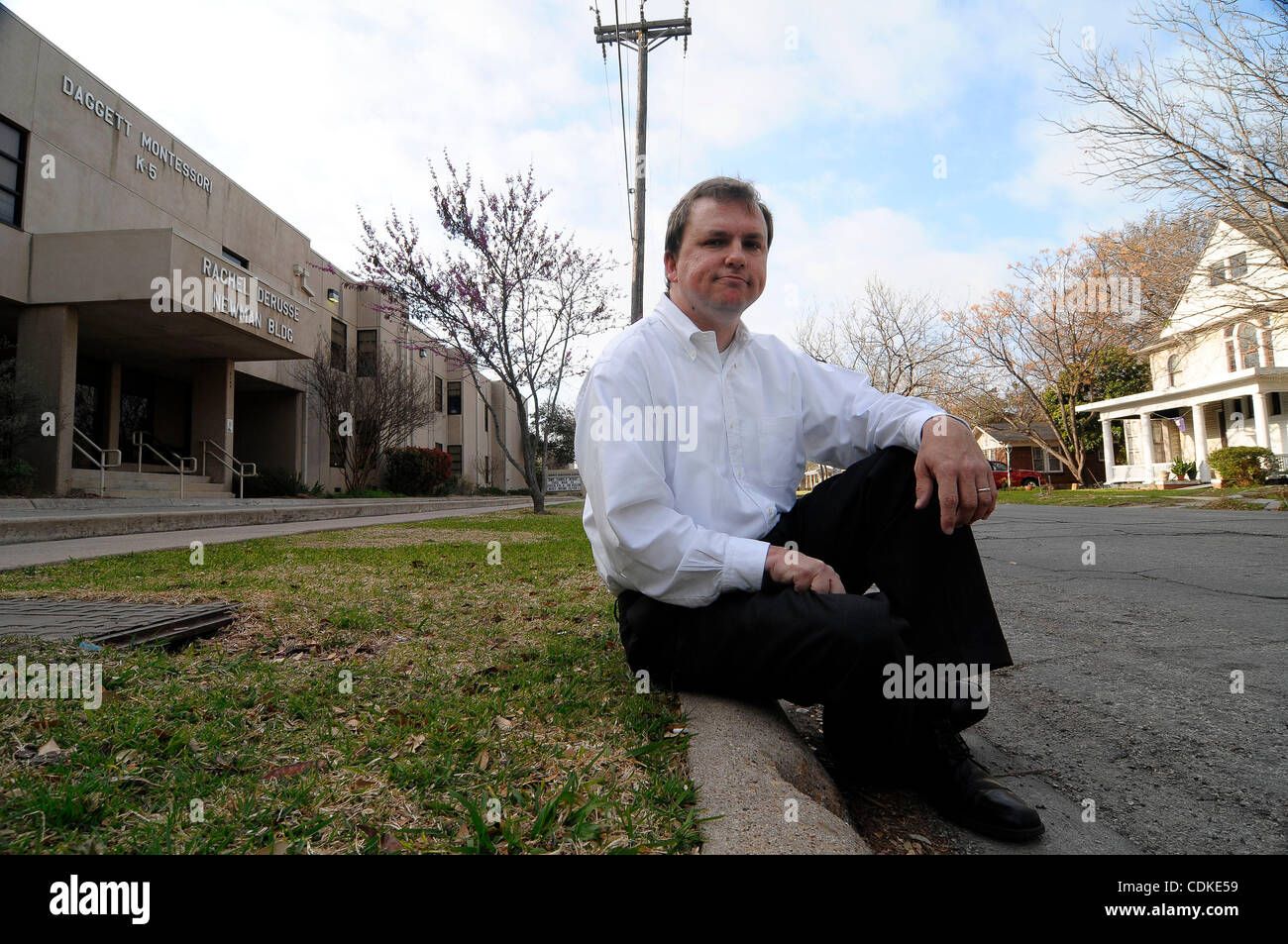 Mar. 17, 2011 - Weatherford, Texas, USA - 3/17/2011.   JASON C.N. SMITH sits in front of Daggett Montessori school - Stock Image