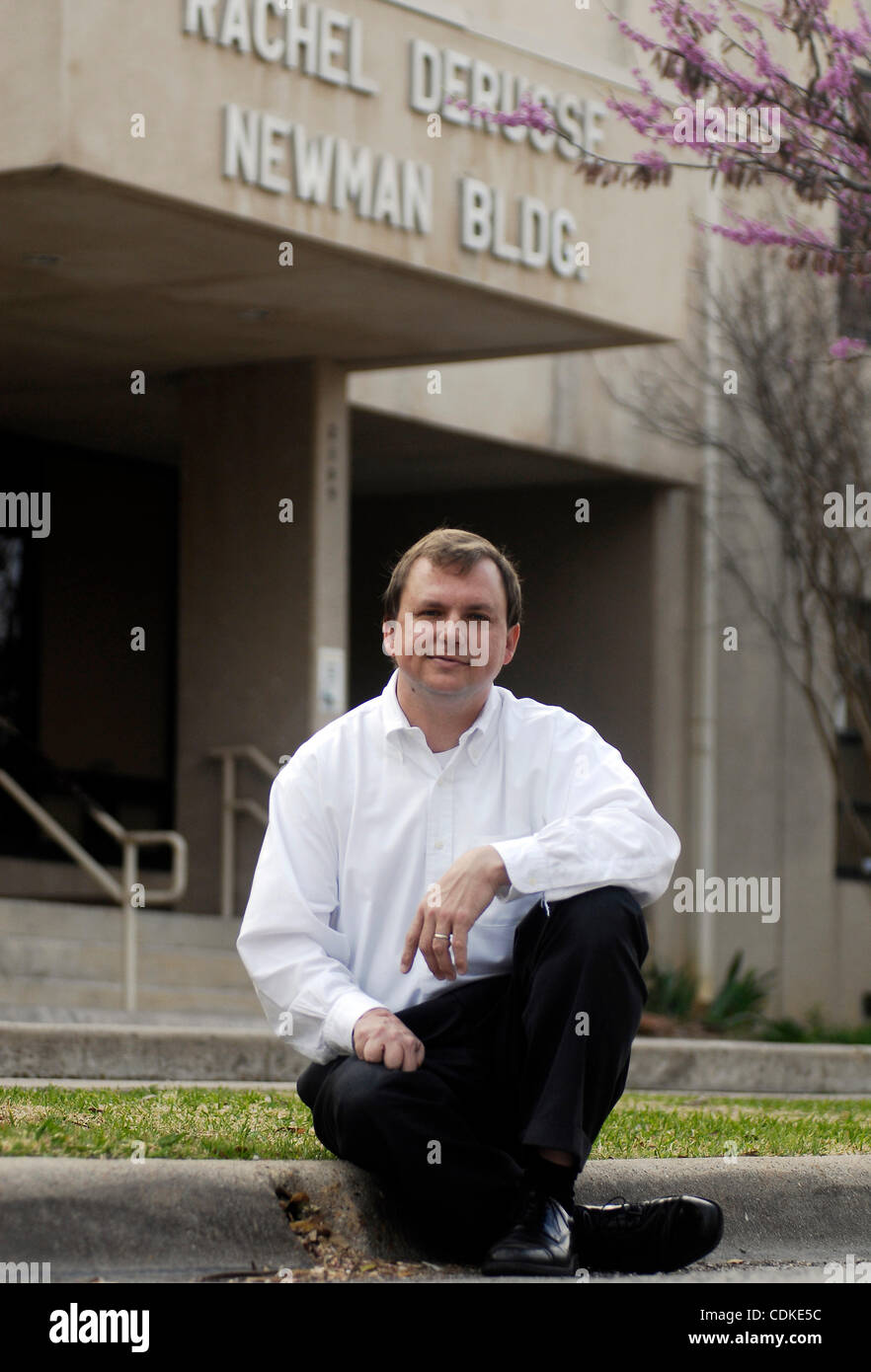 Mar. 17, 2011 - Weatherford, Texas, USA - 3/17/2011. JASON  C.N. SMITH sits in front of the Daggett Montesorri school - Stock Image