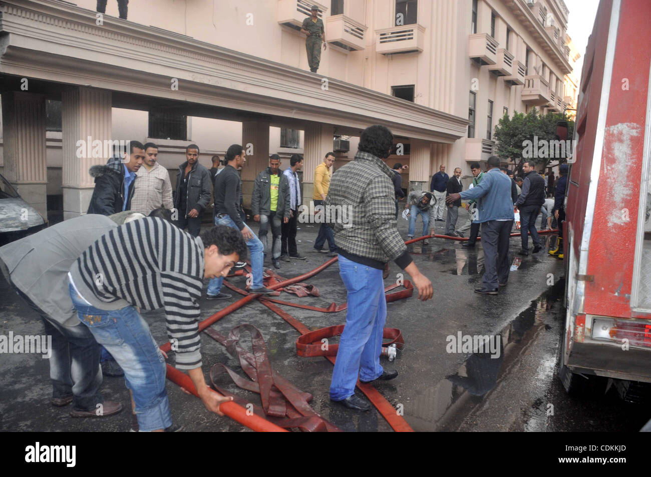 Egyptian firefighters operate on one of the building of the Interior Ministry after a fire erupted, in Cairo, Egypt, - Stock Image