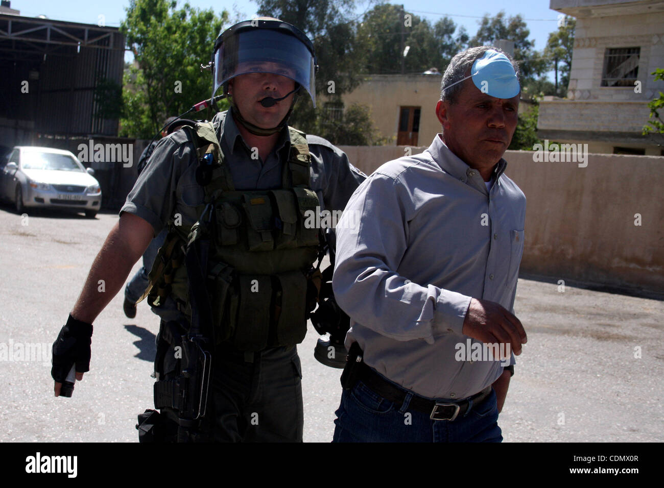 Apr 15, 2011 - Ramallah, West Bank, Palestinian Territory - An Israeli soldier detains a demonstrator during a protest Stock Photo
