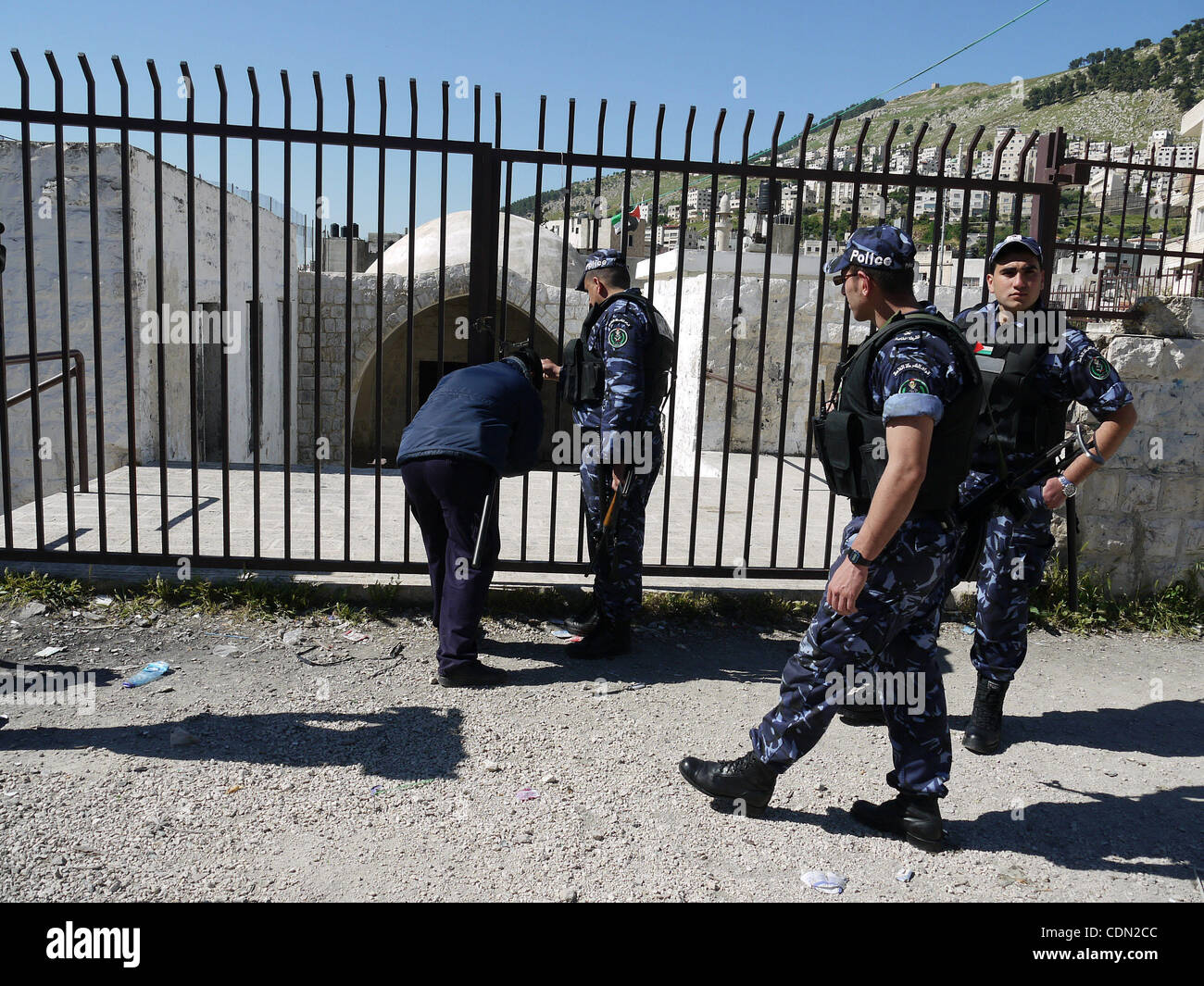 Apr 24, 2011 - Nablus, West Bank - Members of the Palestinian police block the gate of 'Joseph's Tomb' - Stock Image
