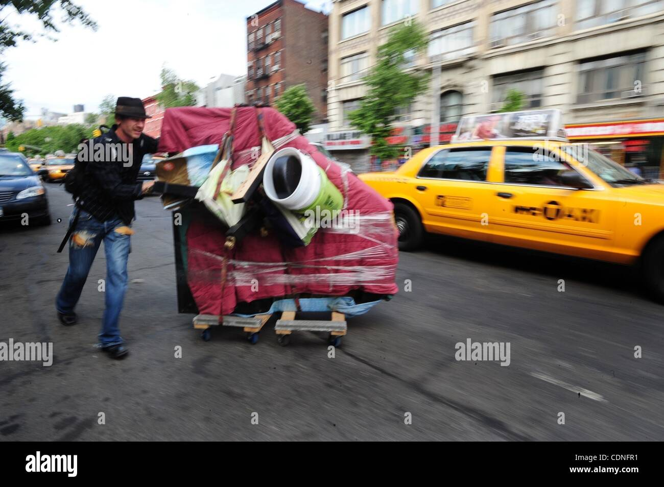 June 4, 2011 - Manhattan, New York, U.S. - Colin wheels the piano up Sixth Avenue. COLIN HUGGINS of The East Village - Stock Image