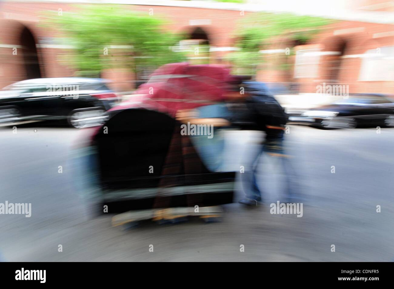 June 4, 2011 - Manhattan, New York, U.S. - Colin wheels the piano down Washington Square South. COLIN HUGGINS of - Stock Image