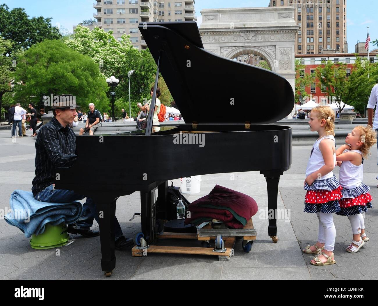 June 4, 2011 - Manhattan, New York, U.S. - Sisters Juliet and Victoria look on as Colin plays the piano in Washington - Stock Image
