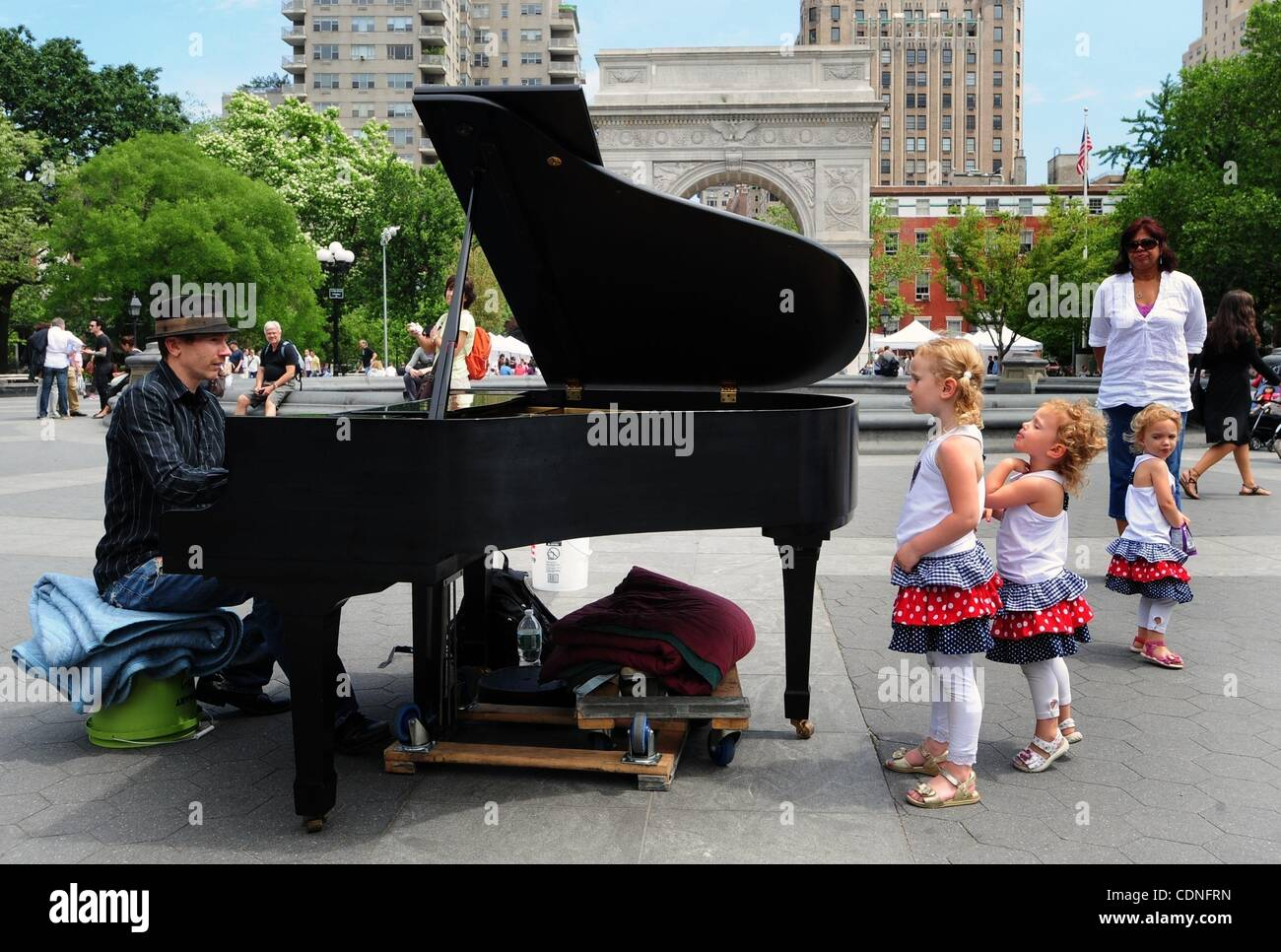 June 4, 2011 - Manhattan, New York, U.S. - Sisters Juliet, Victoria and Diana look on as Colin plays the piano in - Stock Image
