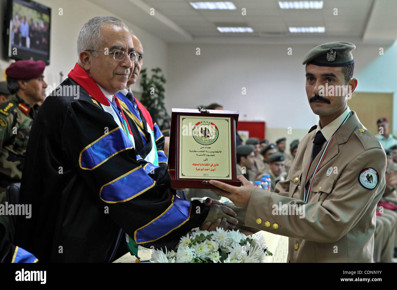 Palestinian Prime Minister, Salam Fayyad attends the graduation ceremony of the students of security, intelligence - Stock Image