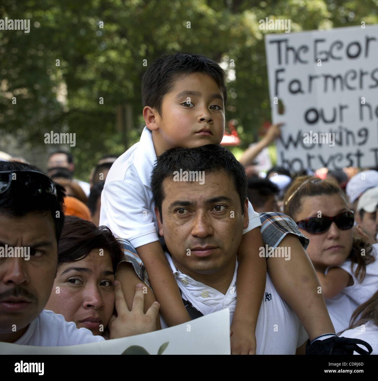 July 2, 2011 - Atlanta, Georgia, U.S. -  JESUS LOPEZ with wife ESTHER holds 5-year-old son JACOB as they watch a - Stock Image