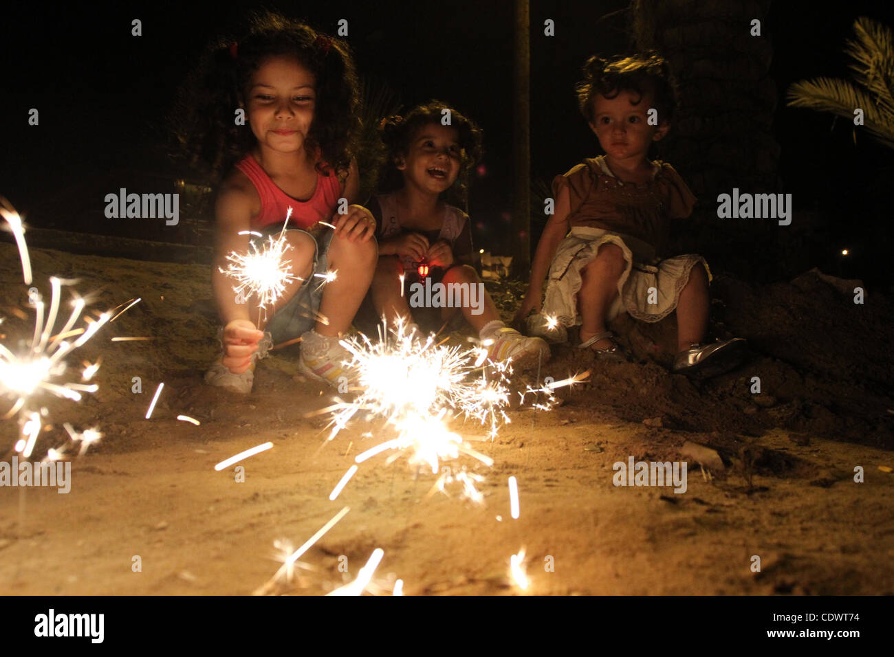 Palestinian Children Enjoy Playing With Fire Crackers