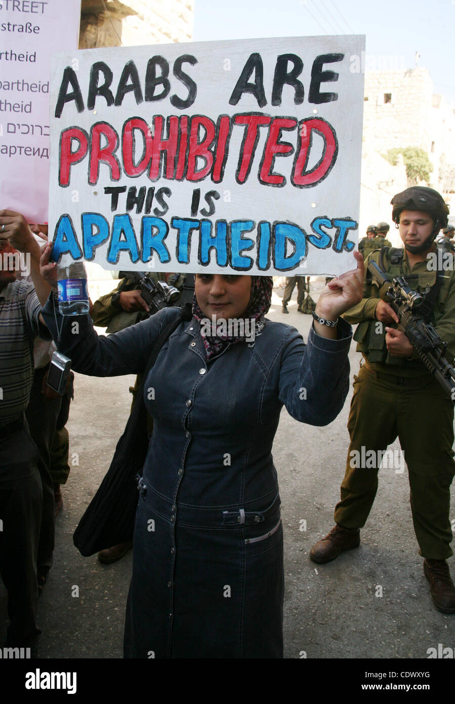 Palestinians take part in a rally against the closure of Shuhada Street in Hebron, the main artery blocked by an - Stock Image