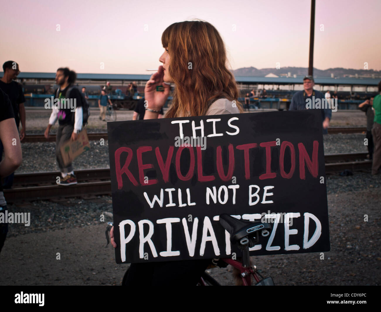 Nov. 02, 2011 - Oakland, California, U.S. - A Demonstrator holds a sign 'The Revolution Will Not Be Privatized' - Stock Image