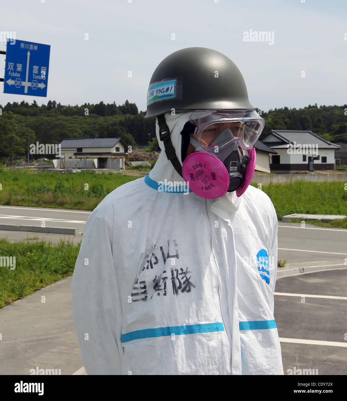 July 24, 2011 - Okuma, Japan - Members of Japanese self-defence forces wearing protective gear during a memorial - Stock Image