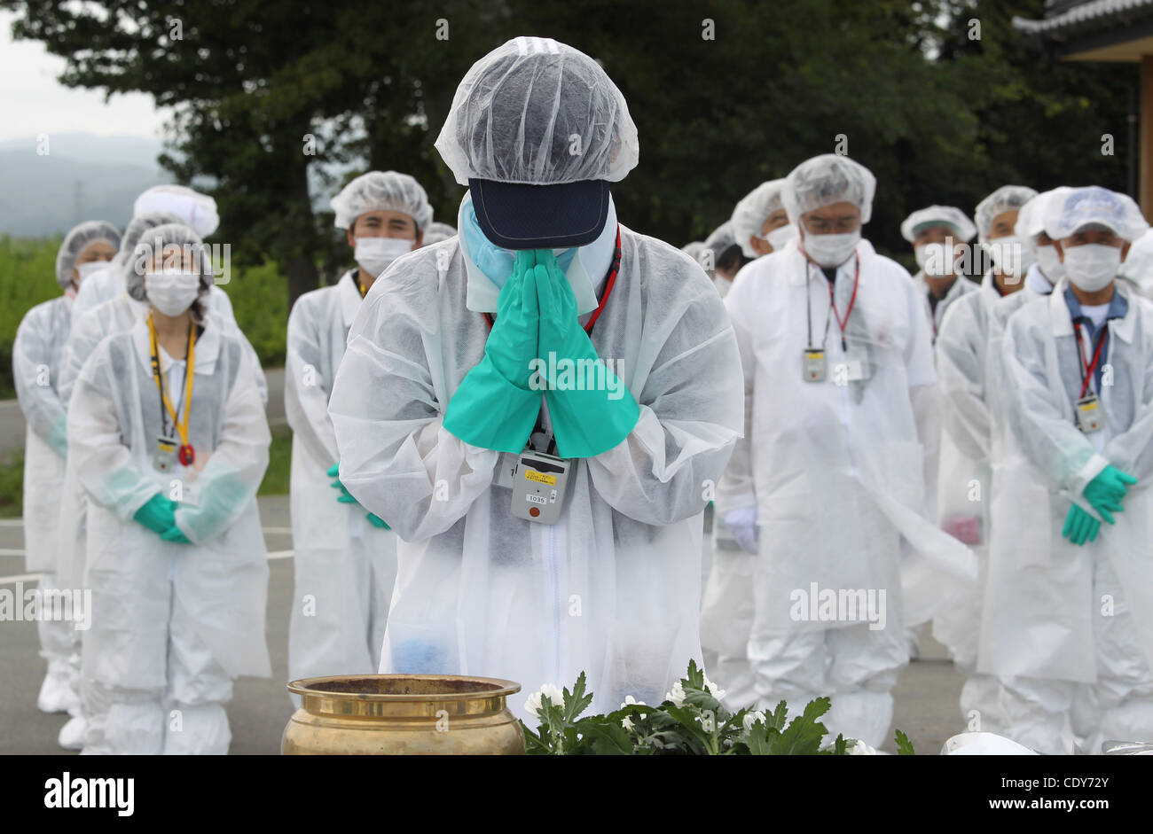 July 24, 2011 - Okuma, Japan - Residents of Okuma-cho prays during a memorial service for victims of the March 11 - Stock Image