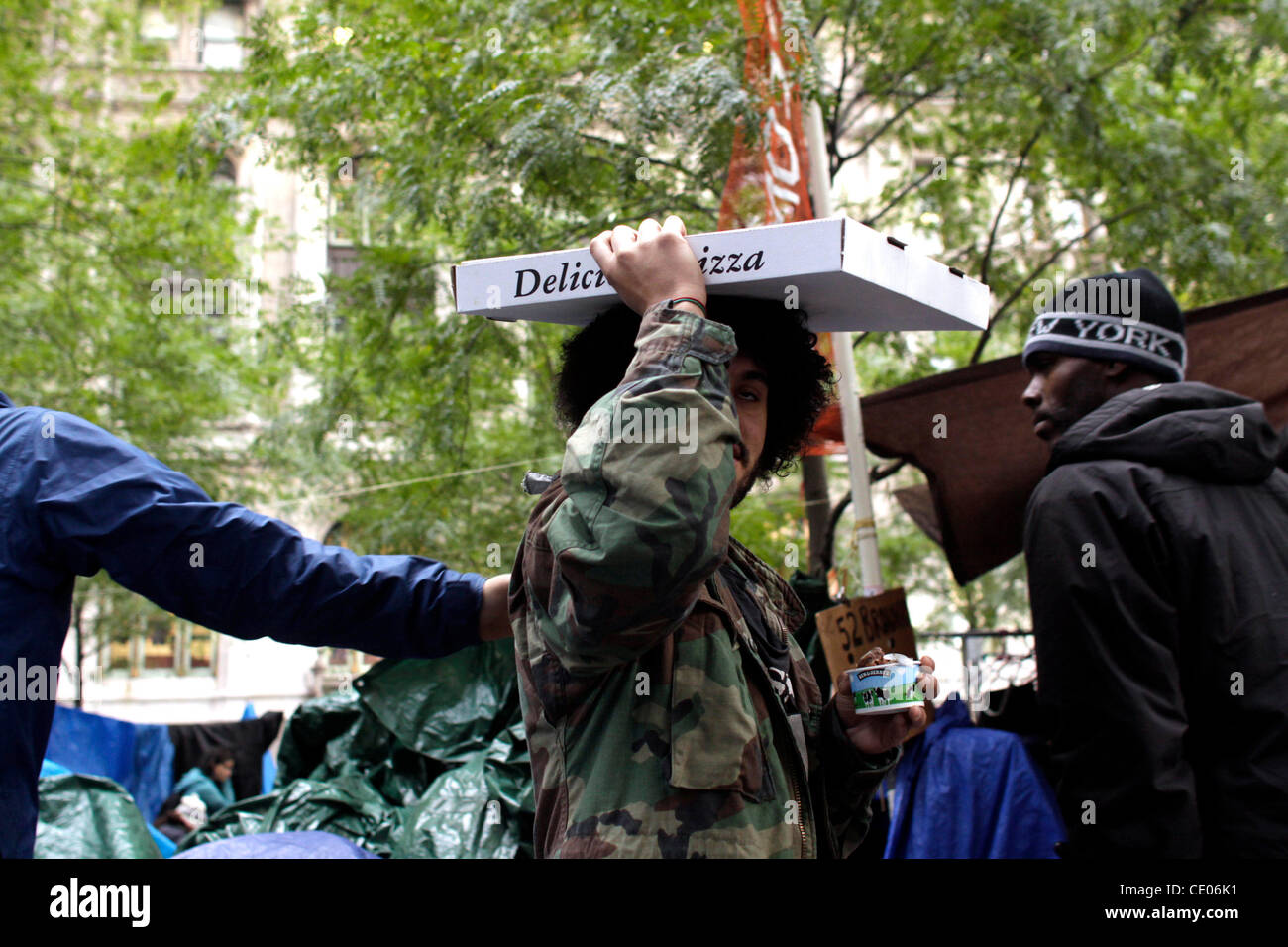 A protester with pizza at Occupy Wall Street in Zuccotti Park. Stock Photo