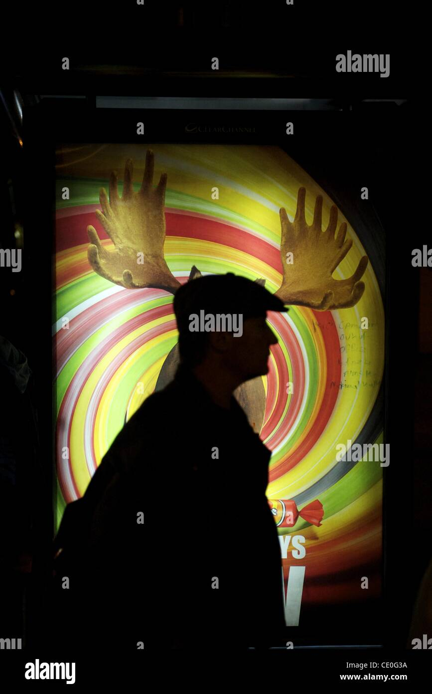 Sept. 22, 2011 - London, England, UK - A shilouetted man is juxtaposed with a candy poster advertisement featuring - Stock Image