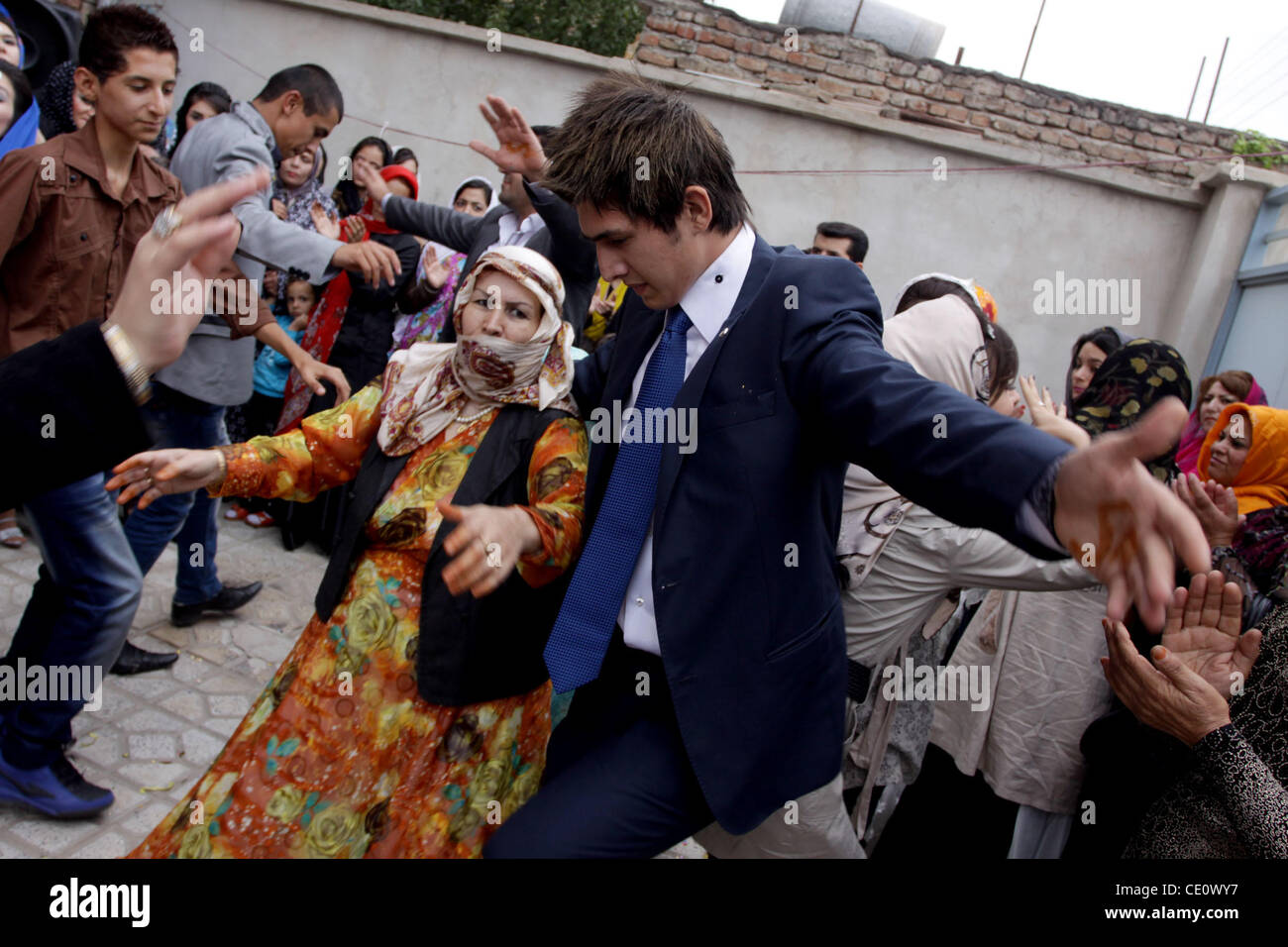 September 11, 2011: Samad (Right - 17 years old) dances with his mother Sorayya (Left - 49 years old) who has worn - Stock Image
