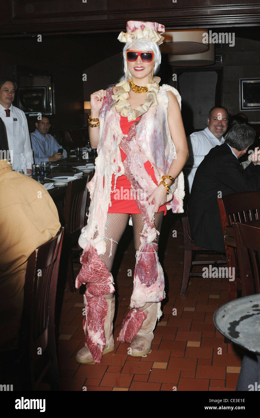 model mery lopez displays a one of a kind lady gaga inspired meat dress which has been put up for sale at the old homestead steak house in new york