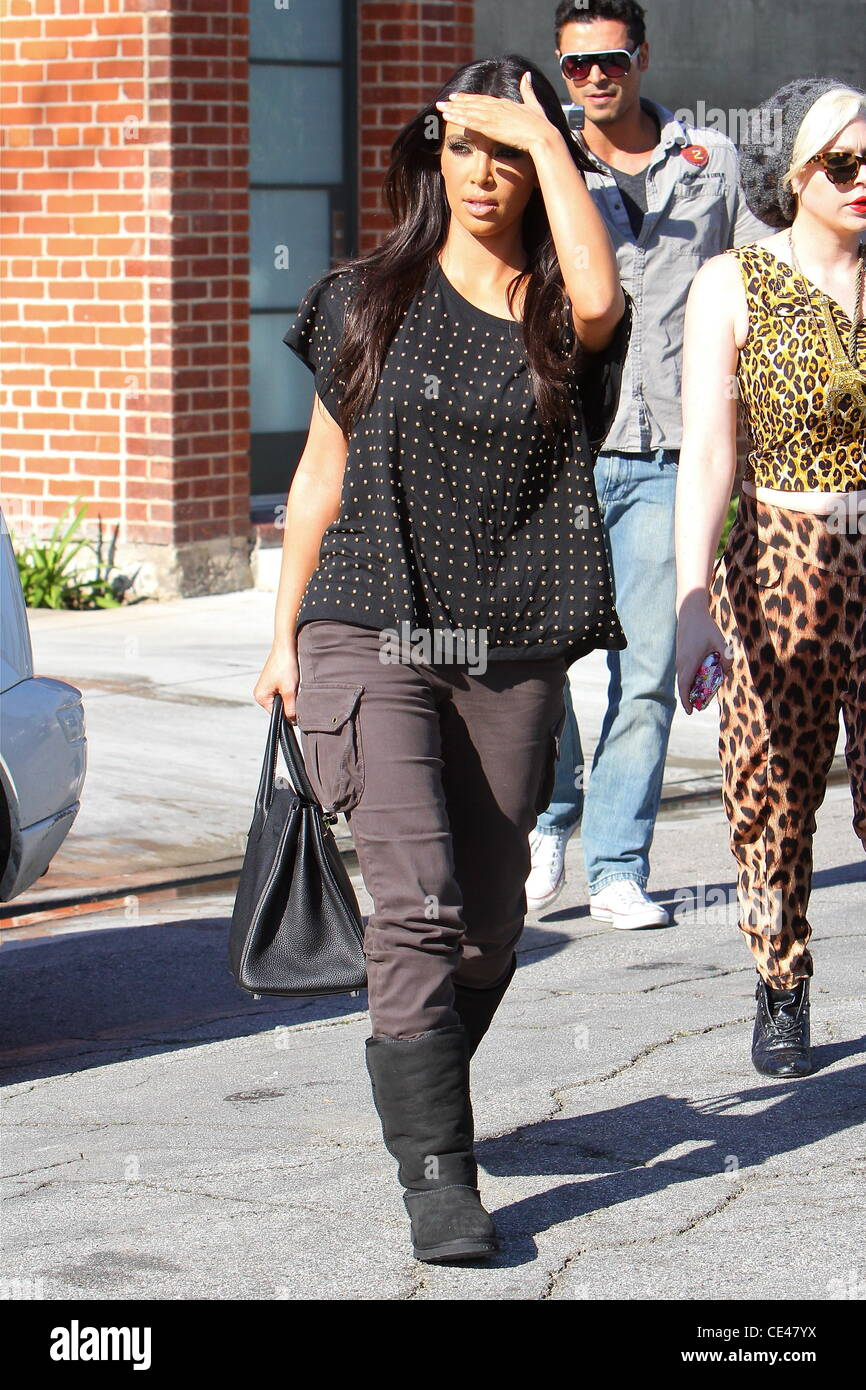 96dd5505bcf9 Kim Kardashian is seen wearing Ugg boots and an Hermes Birkin bag as she  heads to a studio in Culver City. Los Angeles