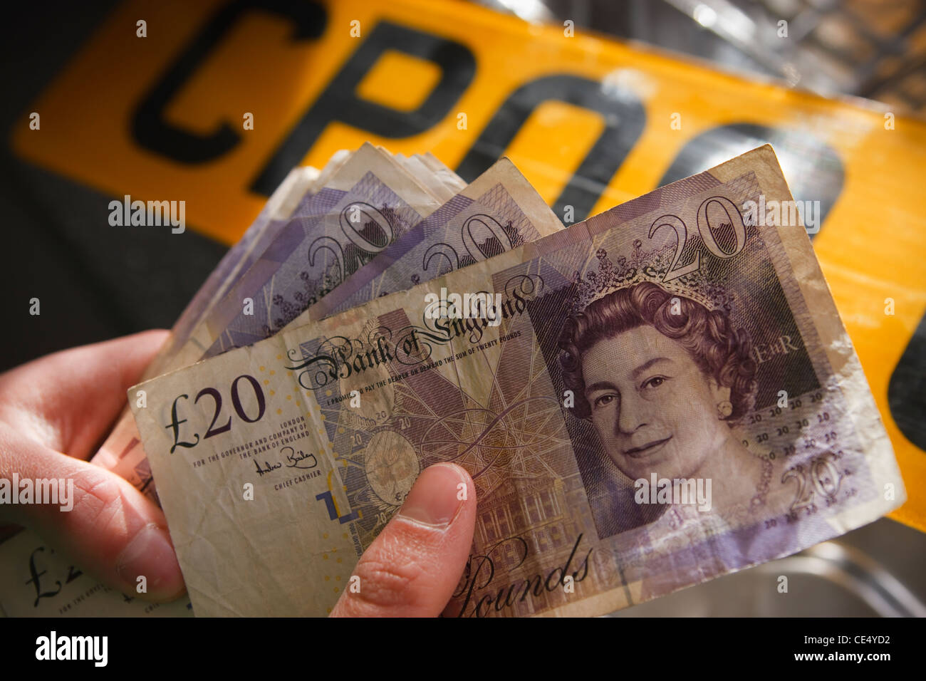 holding fan money £20 notes GBR sterling currency number plate - Stock Image