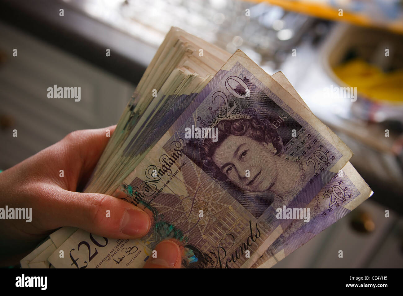 holding fan money £20 notes GBR sterling currency view landscape young man teenager model released hands stash - Stock Image