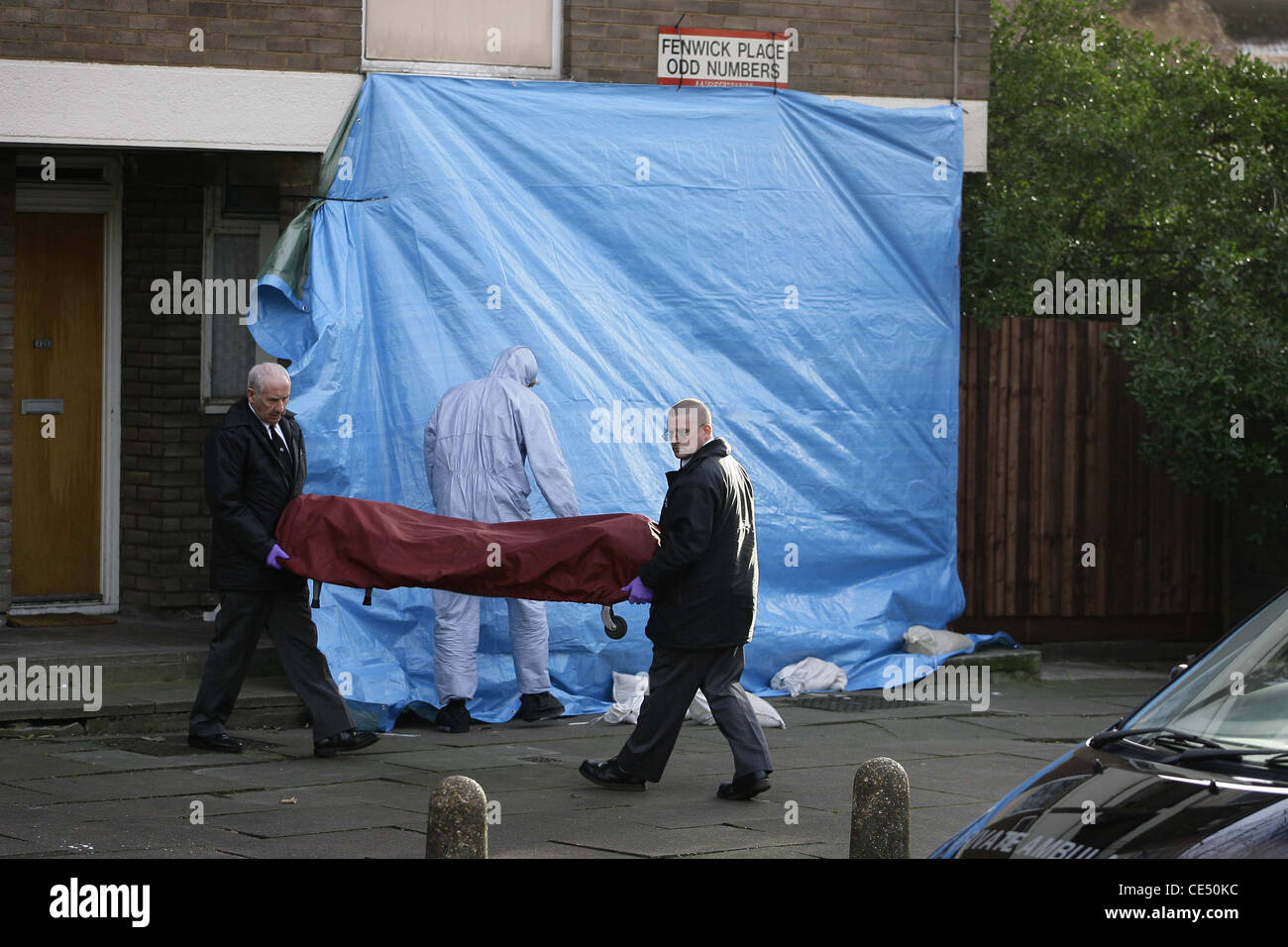 The body of a murdered 15 year old boy is removed from the