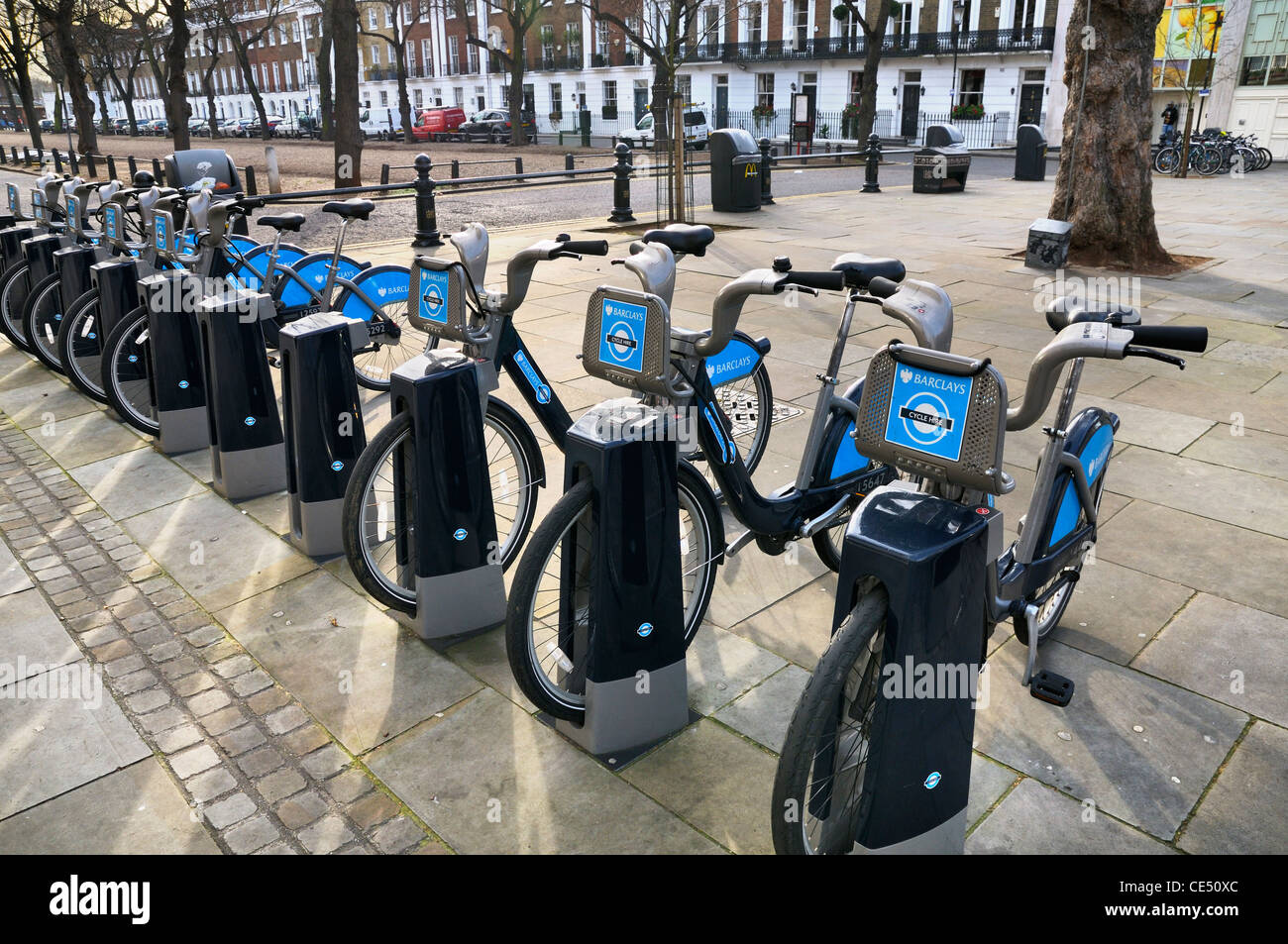Barclays Cycle Hire scheme (aka 'Boris bikes') on the King's Road, Chelsea, London, SW3, UK - Stock Image