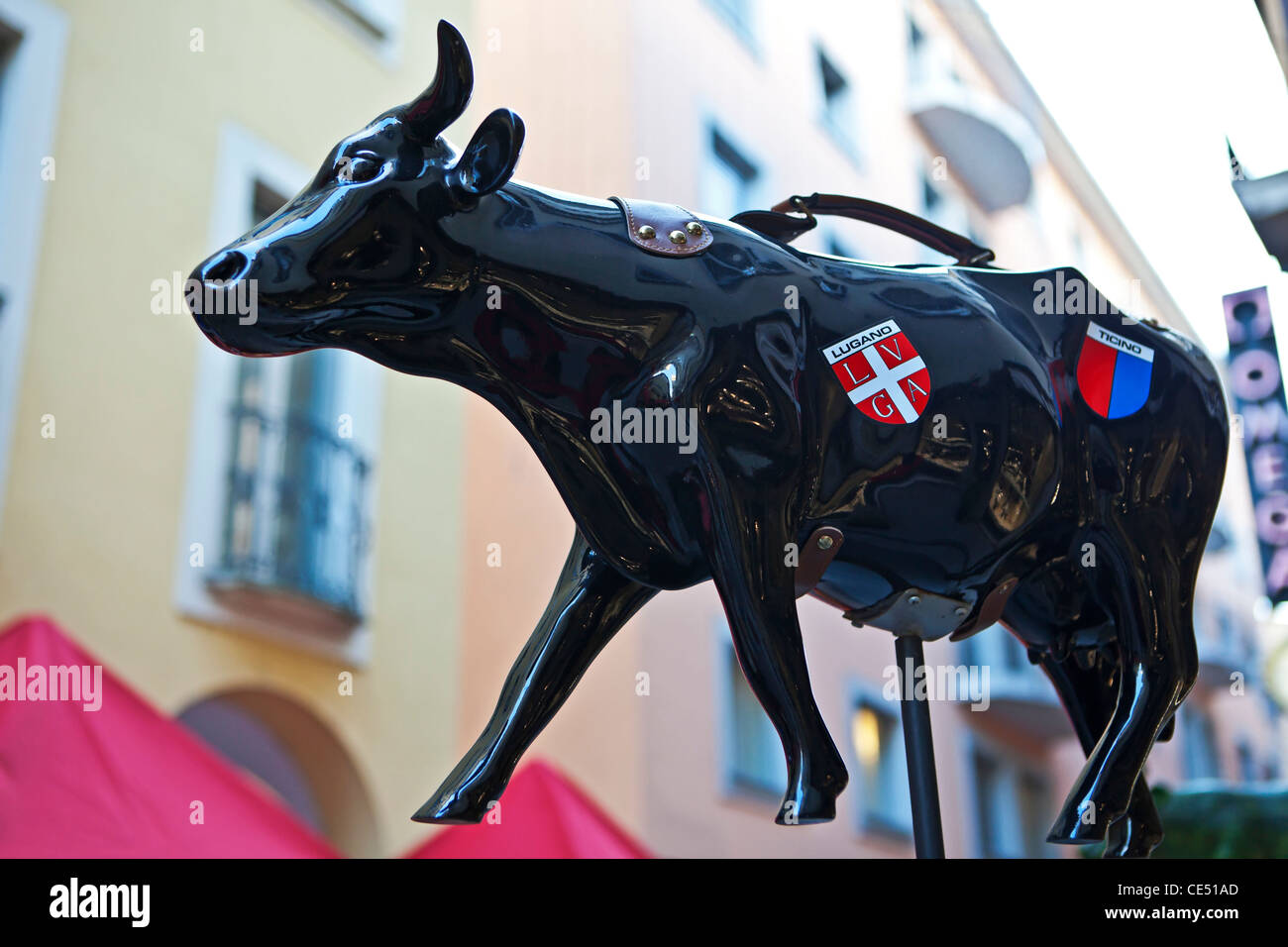 Figure of a Swiss cow with coat of arms of the canton of Ticino and Lugano. - Stock Image